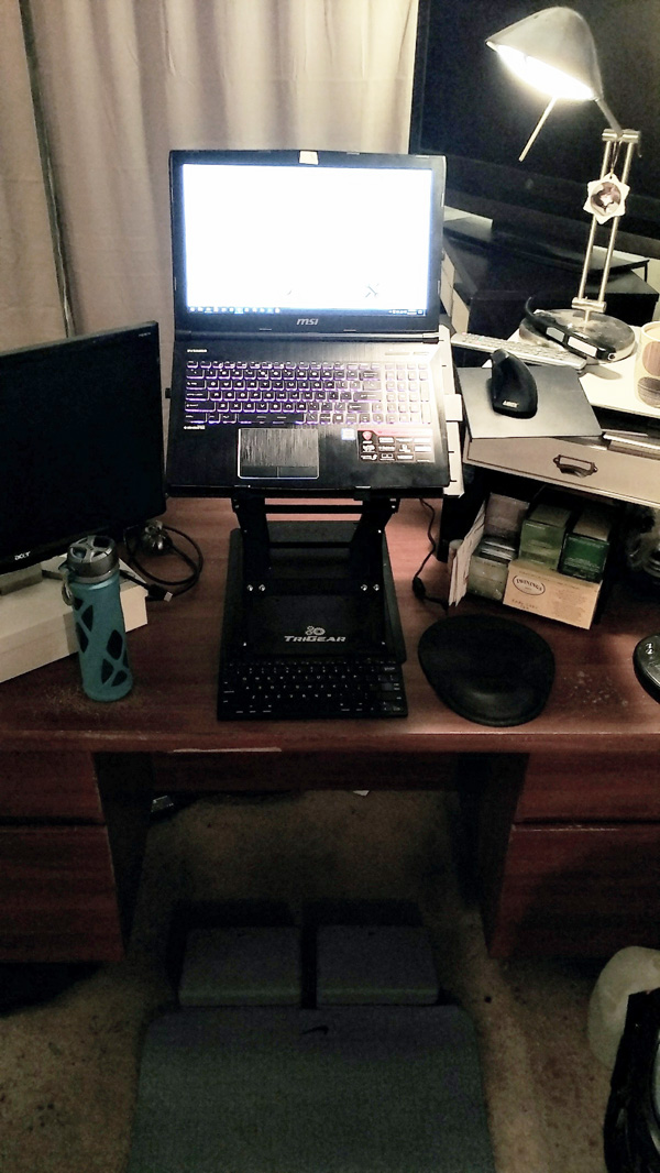 Standing desk setup with mat